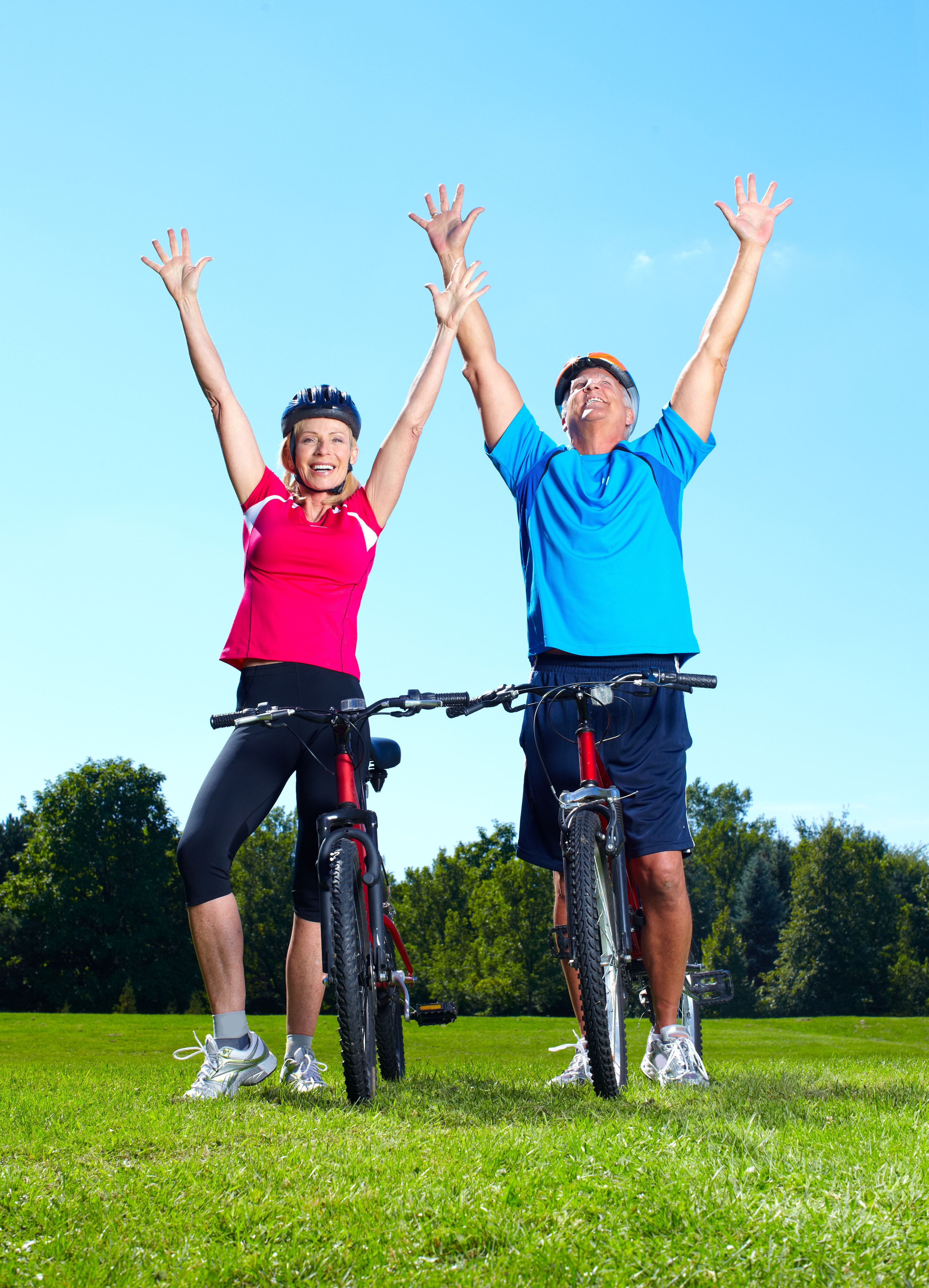 seniors-astride-cycles-hands-in-air-